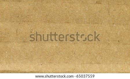 Brown grunge corrugated cardboard sheet useful as a background - (16:9 ratio) - stock photo