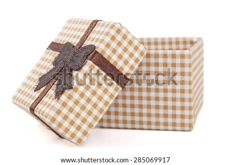 Brown jewelry ring cardboard box with pattern and ribbon isolated on white background - stock photo