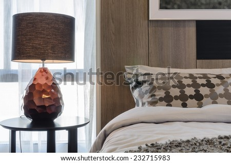 brown lamp on round table in bedroom - stock photo