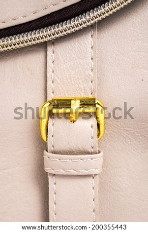 Brown leather background with a gold belt - stock photo