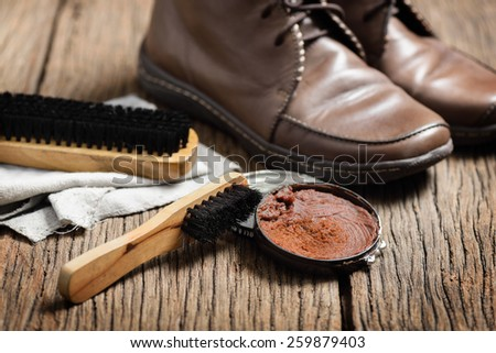 brown leather boots with shoe maintenance set - stock photo