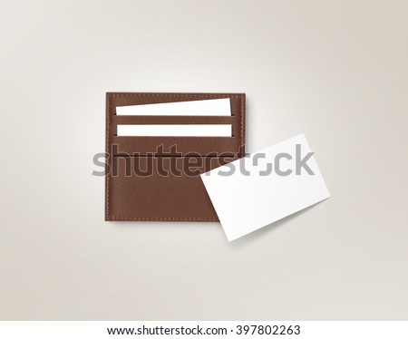 Brown leather card holder with blank white card mock up isolated on grey. Business credit cards mockup in sleeve cardholder pocket. Clear paper employee id cards in grey wallet box. Logo design card. - stock photo