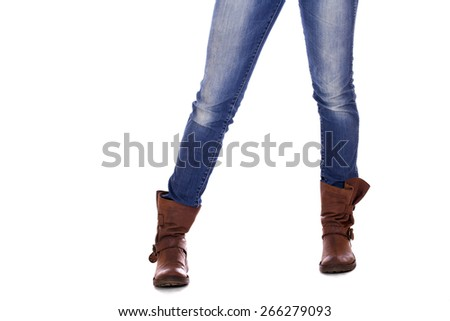 Brown leather female boots and blue jeans, isolated on white background - stock photo