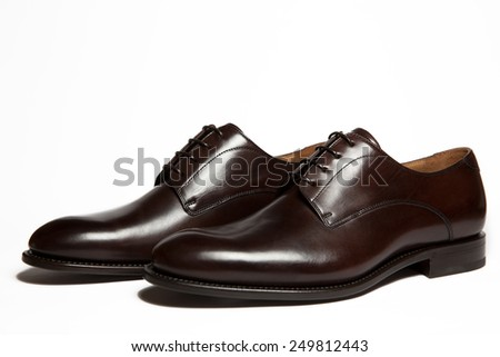Brown leather men's shoes isolated on white background - stock photo