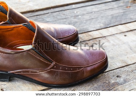 brown leather shoes on the wooden background - stock photo