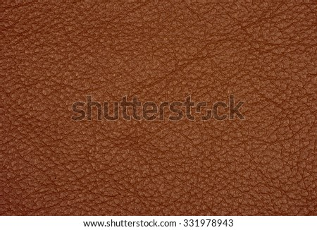 brown leather texture closeup can be used as background. - stock photo