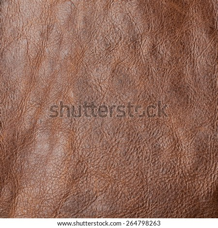 Brown leather texture fragment as a background composition - stock photo