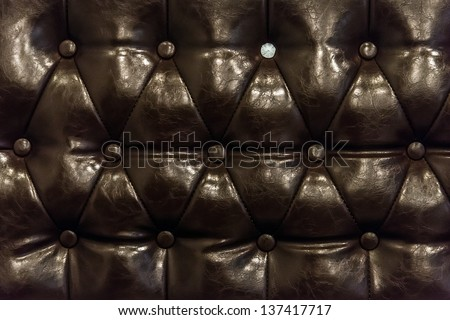 brown leather texture of sofa closeup shot - stock photo