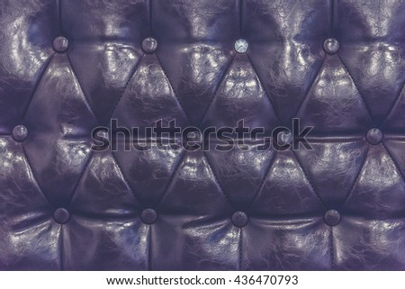 brown leather texture of sofa closeup shot (Vintage filter effect used) - stock photo