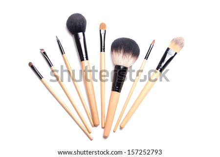 brown make-up brushes isolated on white background - stock photo