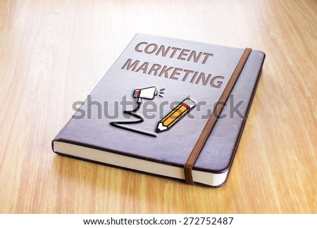 Brown notebook with Content marketing word and pencil with speaker icon on wood table, Technology concept - stock photo