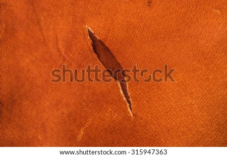 Brown, Orange Tan Leather Tear. Concept and Idea Style of Fine Leather Crafting, Handcrafts, Handmade, handcrafted, leather worker. Background Textured and Wallpaper. Vintage Rustic Style. - stock photo