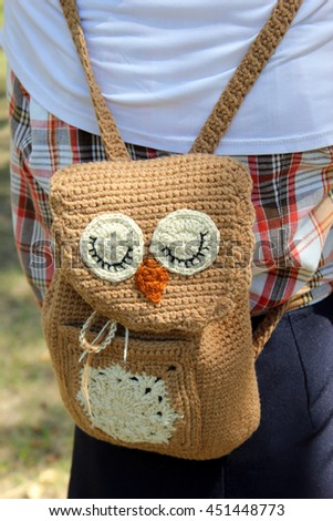 Brown Owl Backpack crochet on the back of a girl. - stock photo