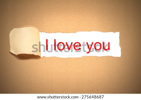 brown paper envelope torn to reveal message i love you - stock photo