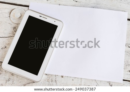 brown paper for your text on wooden table with digital tablet - stock photo
