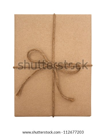 Brown paper package tied with string on a white background - stock photo