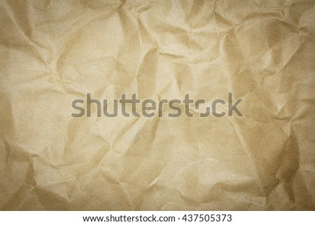 Brown paper sheet. Closeup recycled crumpled brown paper texture. Recycled crumpled brown paper background with copy space for text or image. Dark edged. - stock photo
