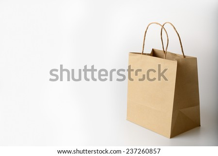 brown paper shopping bag on white background - stock photo