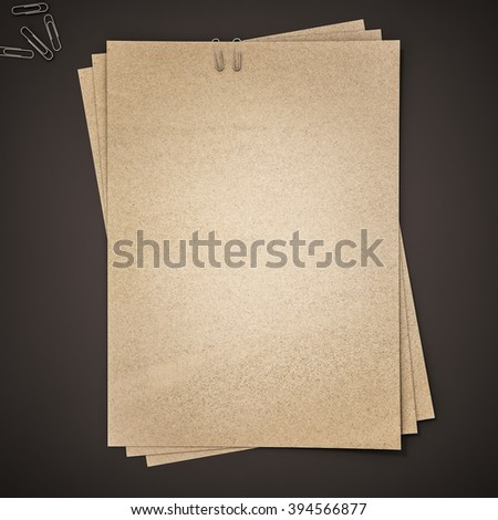Brown paper with clips on black background, 3d rendered - stock photo