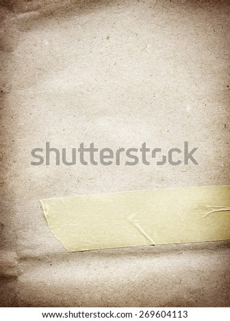 Brown parchment paper texture with adhesive, sticky tape - stock photo