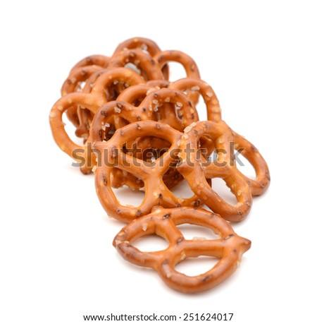 brown pretzels closeup isolated on white - stock photo