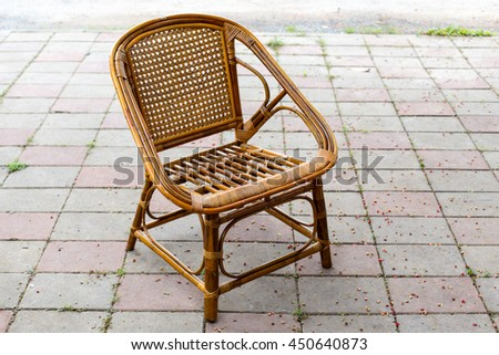 Brown rattan Chair on the patio floor - stock photo