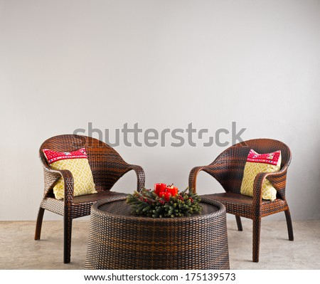 Brown rattan chairs and table and flowers - stock photo