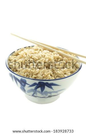 Brown rice and chopsticks - stock photo