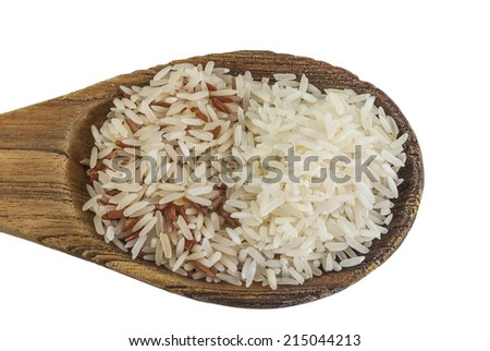 brown rice and white rice on wooden spoon - stock photo
