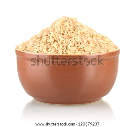 brown rice in a brown plate , isolated on white - stock photo