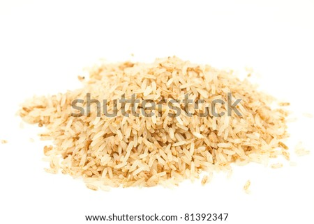 Brown rice isolated on the white. - stock photo