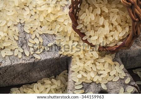 brown rice on cutting board - stock photo