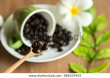 Brown roasted coffee beans, seed with spoon. Espresso dark, aroma, black caffeine drink. Closeup isolated energy mocha, cappuccino ingredient. - stock photo
