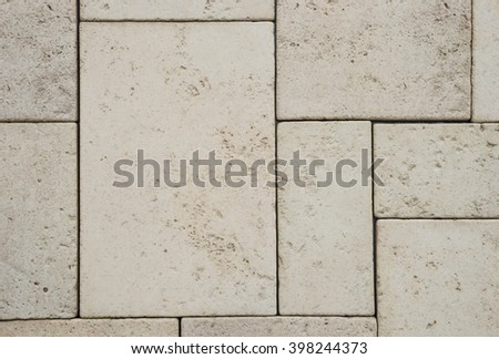 Brown sandstone tile wall texture and background - stock photo