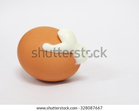 brown shell boiled broken egg with steam cooked with white egg pop out from the crack making white soft figure form on the egg surface, picture taken on white paper background - stock photo
