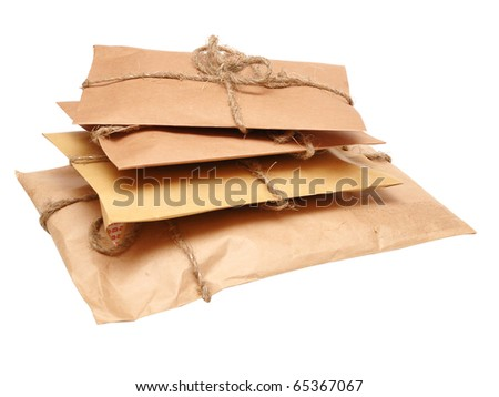 brown shipping parcel tied with twine on white - stock photo