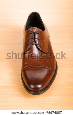 Brown shoes on wooden table - stock photo