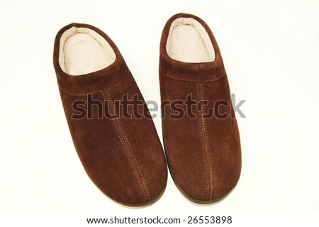 brown slippers on white background - stock photo
