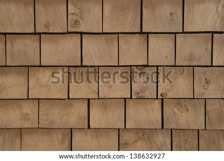 Brown stained cedar shingle from a wall. Background and texture. - stock photo