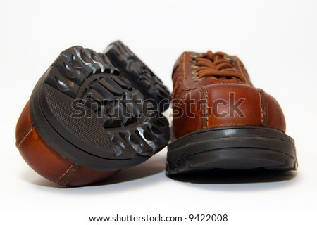brown steel-toe boots - stock photo