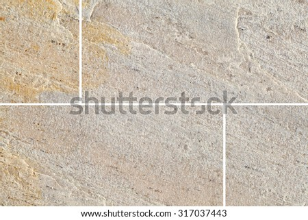 Brown stone floor tile seamless background and texture - stock photo