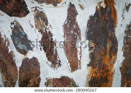 Brown stone wall to use as wallpaper - stock photo