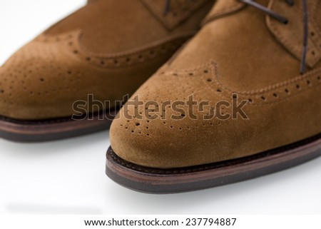 brown suede derby wingtip brogue shoes close up - stock photo