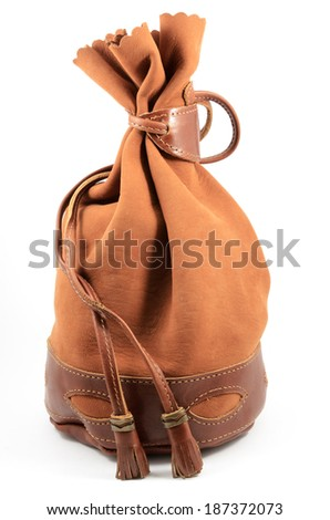 brown suede pouch on white background, vertical - stock photo