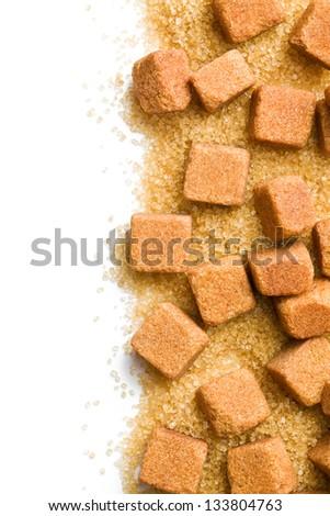 brown sugar cubes and crystal sugar - stock photo