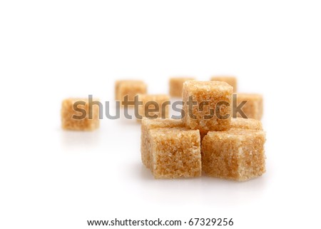 Brown Sugar cubes isolated with soft shadow. Fucus limited. - stock photo