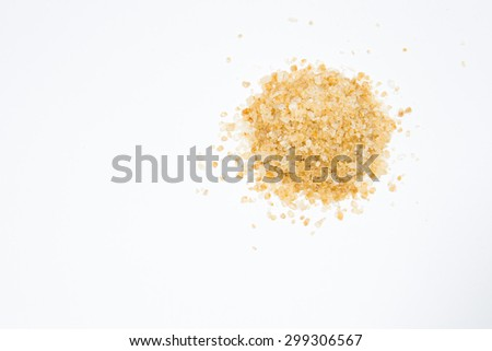 brown sugar heap Sugar on white background - stock photo