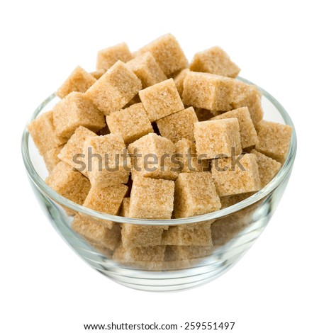 Brown sugar in a glass bowl isolated on a white background. Side view. - stock photo