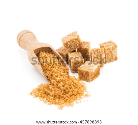 Brown sugar in a wooden scoop isolated on white - stock photo