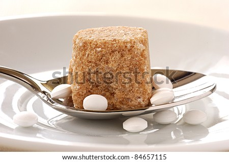 Brown sugar lump and artificial sweetener - stock photo